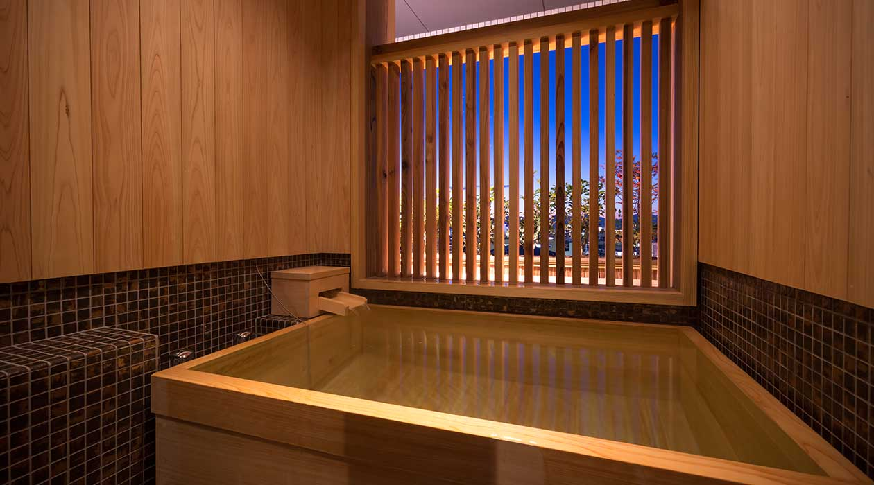 Japanese-style twin room with partial open-air bath (townscape view)